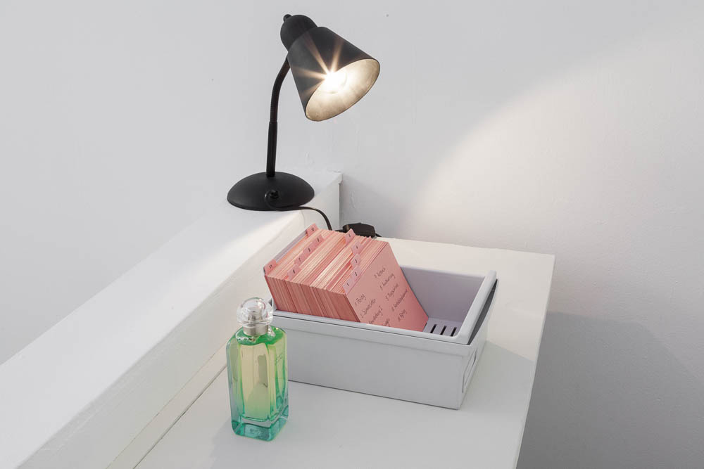 Lynne Kouassi, Love Piece No4, 2017, file card box with file cards, stool, bedside lamp, Un Jardin sur le Nil (perfume by Hermès)