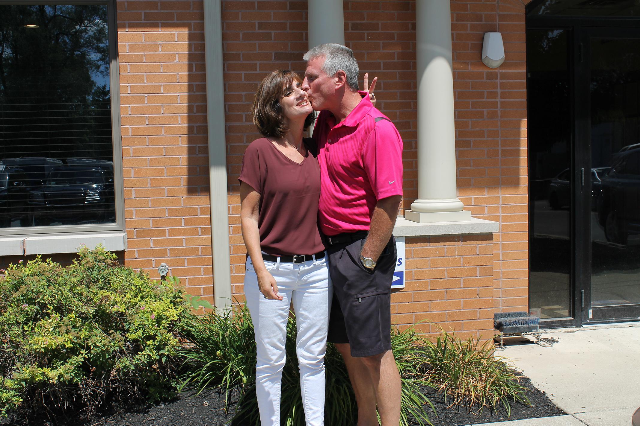 happy customers kissing