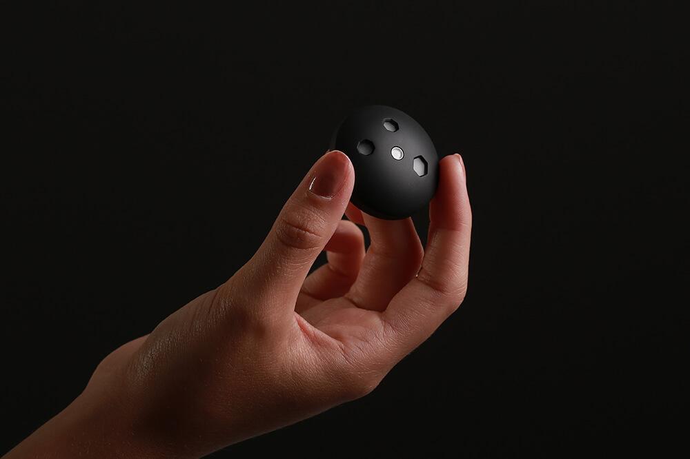 Photo of hand holding Shade sensor