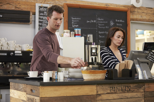 man and woman working in a coffee shop