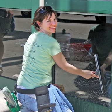 Cathy cleaning a window