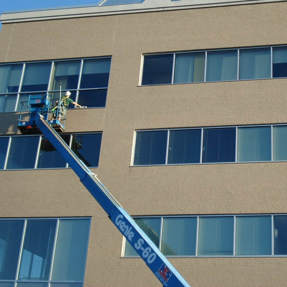 Commercial building getting their windows cleaned.