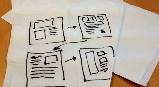 user experience designs sketched on paper napkin