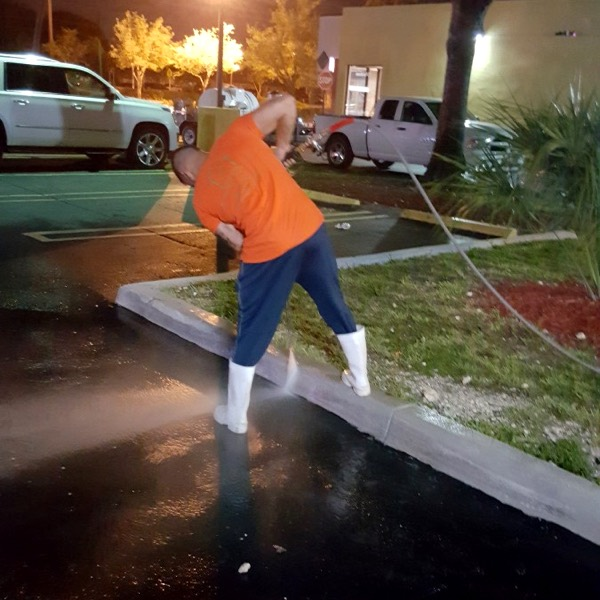 Pressure washing a commercial parking lot