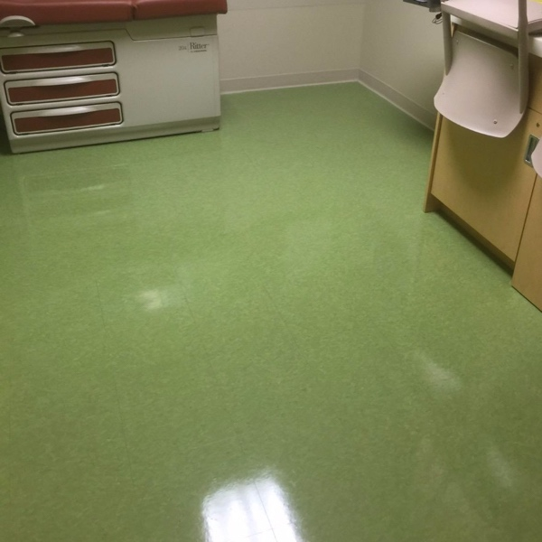 Floor of a commercial office thoroughly cleaned and refinished.