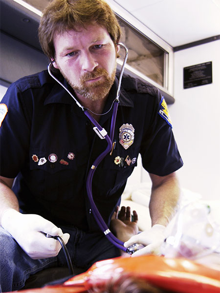 paramedic in ambulance with stethoscope