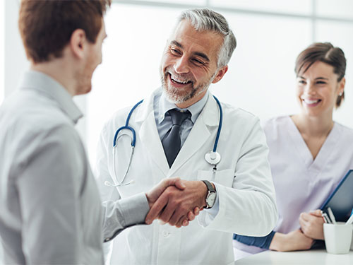 professional man shaking hands with doctor