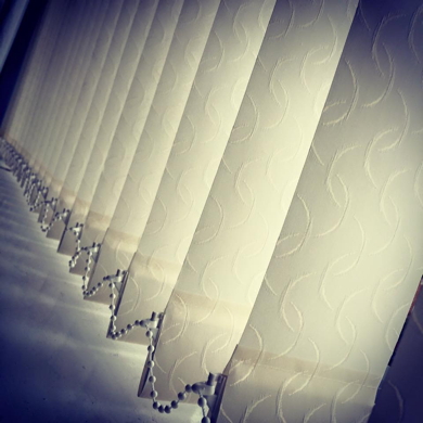 light coloured vertical blinds