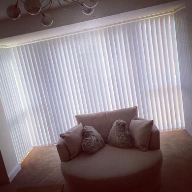 vertical blinds fitted into bay window