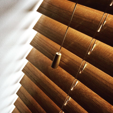 wooden venetian blind close up showing acorn