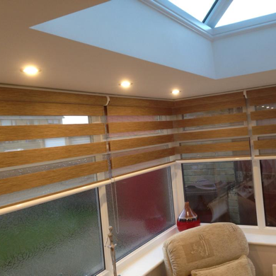 brown wood effect vision blinds in conservatory