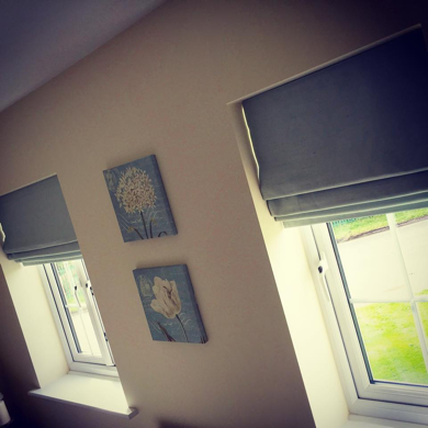 matching roman blinds in light blue fabric