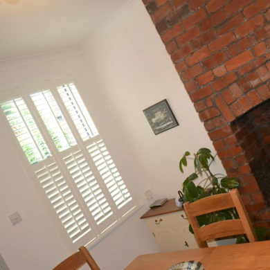 tier on tier shutters in dining room