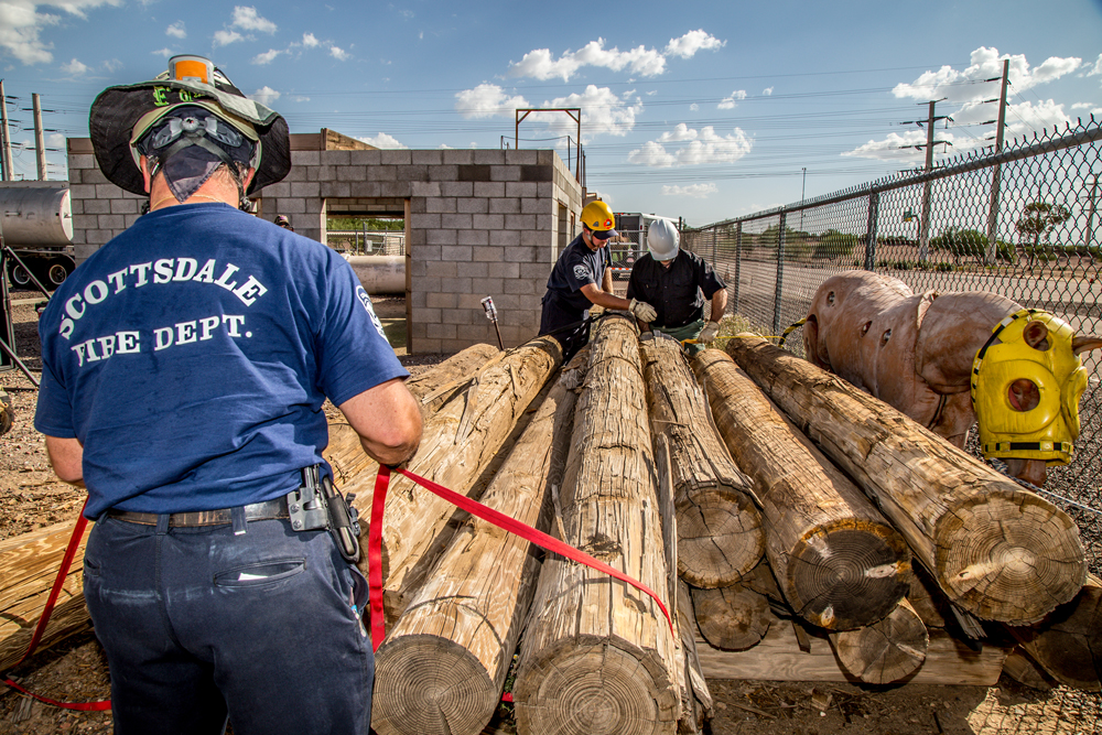 Atwood Ranch Training Men Moving Logs to Unpin Training Horse Image