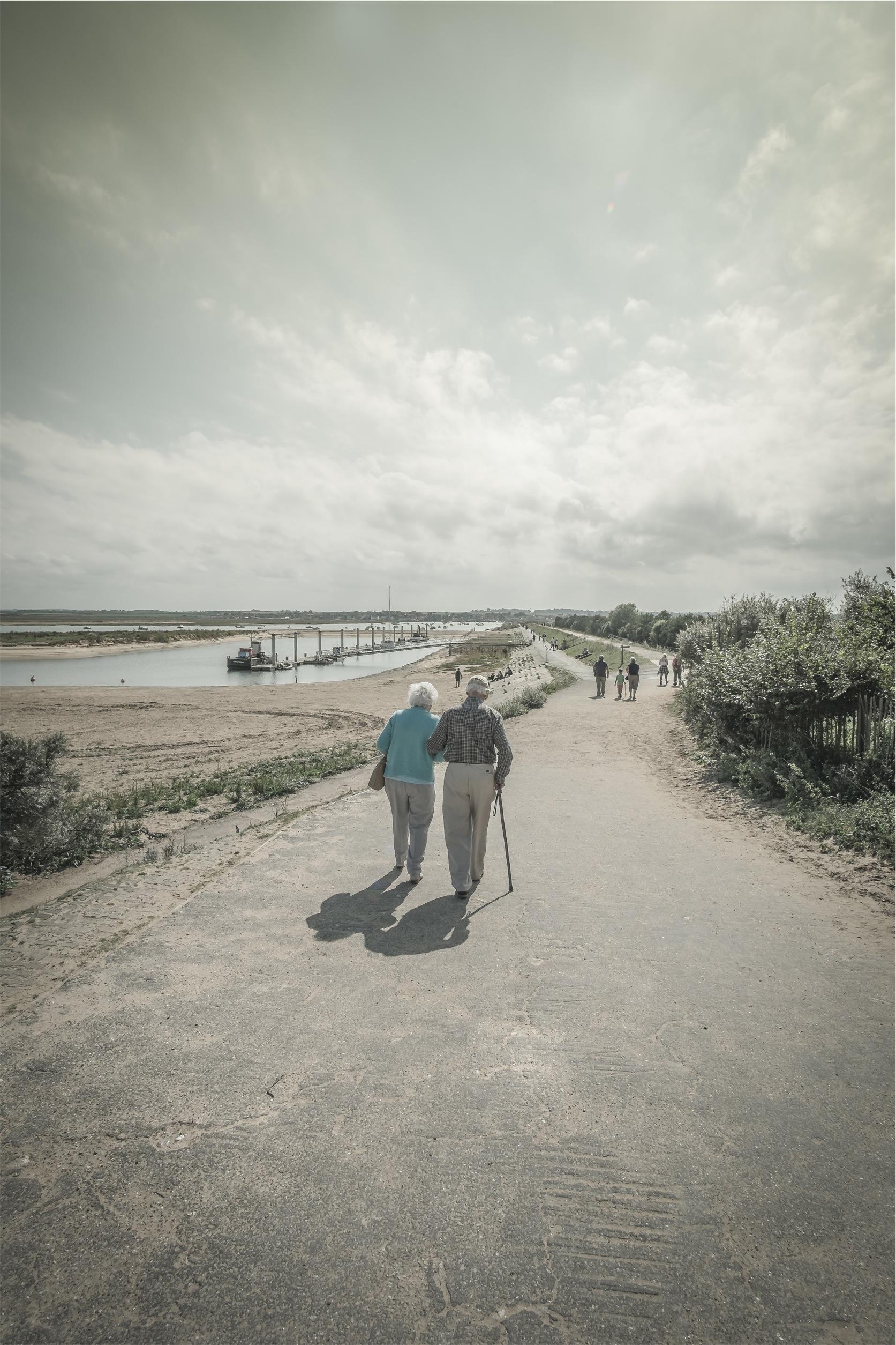 elderly parents walking