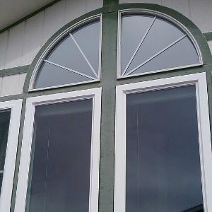 Photo of home window tint on arched windows.