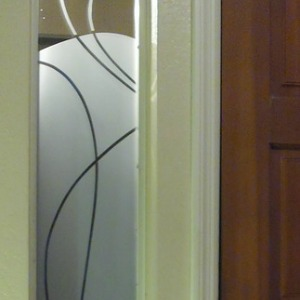 Photo of decorative partition on front door window of a home.