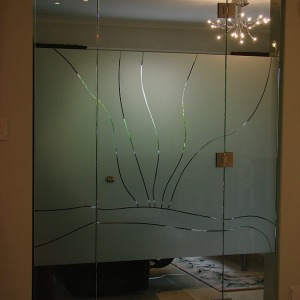 Image of decorative partition on all glass door adding style and privacy.