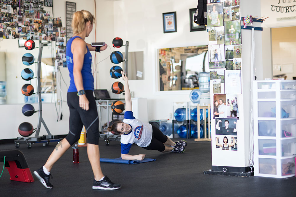 Exercises at Fitness Protection Program involve body weight, dumbbells, medicine balls, steps, plyometrics and other small equipment, as well as some cardio. Classes are good for all fitness levels, from newbie to athlete. (Photo: Valerie Grant)