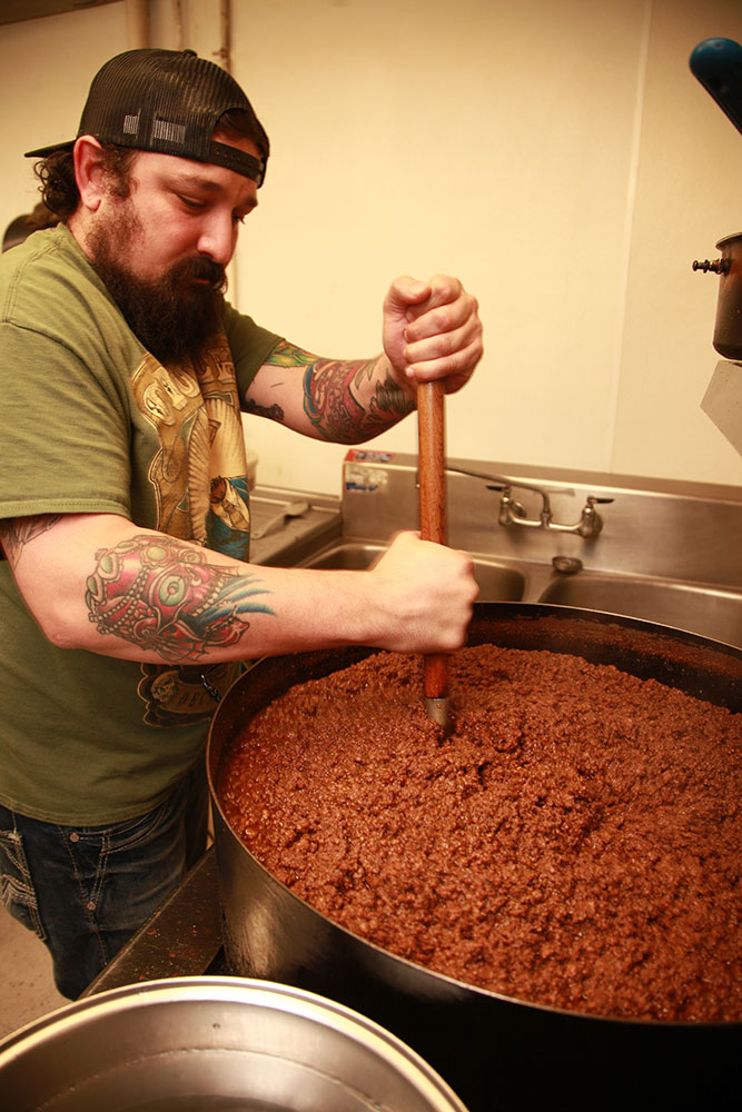 One of Jim's Coney Island's customers comes in from Arizona, picks up 10 pints of chili, and then goes back to Arizona. (Photo: Marc Rains)
