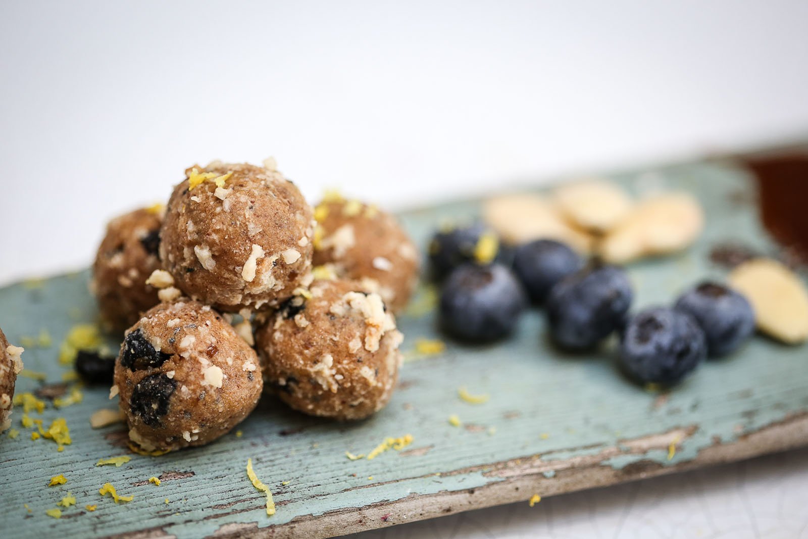 Vegan Blueberry & Chia protein balls on wooden board