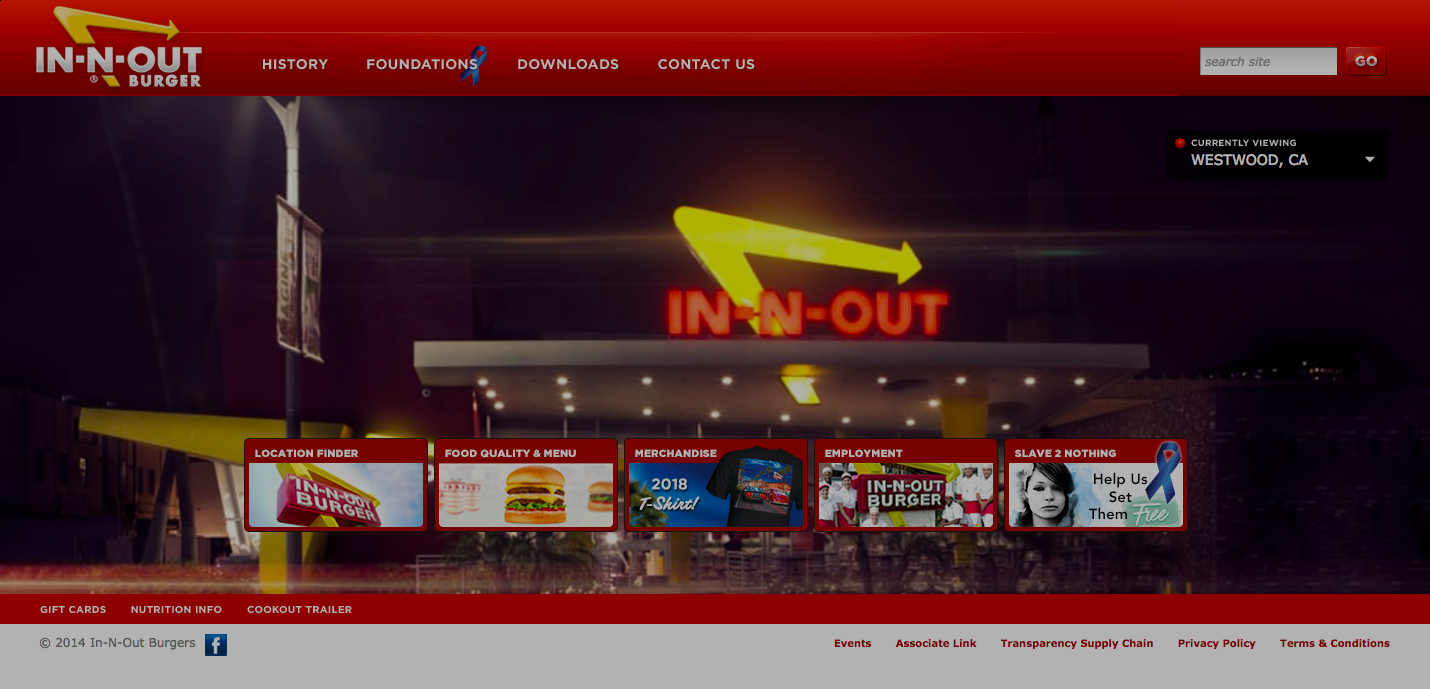 In-N-Out Burger's homepage showing the outside of their restaurant at night. The bright yellow and red neon lights grabbing our attention.