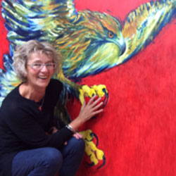 Christine Allison infront of one of her paintings