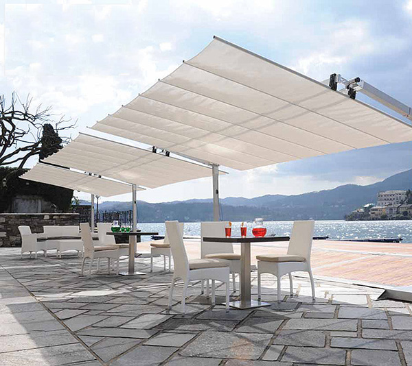 Benchmark' s Flexy Umbrella System will shield you and your co-workers and can be freestanding or in-ground mounted.
