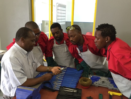 group of workers inspecting tools