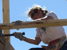 Judith helps with roof trusses in Haiti