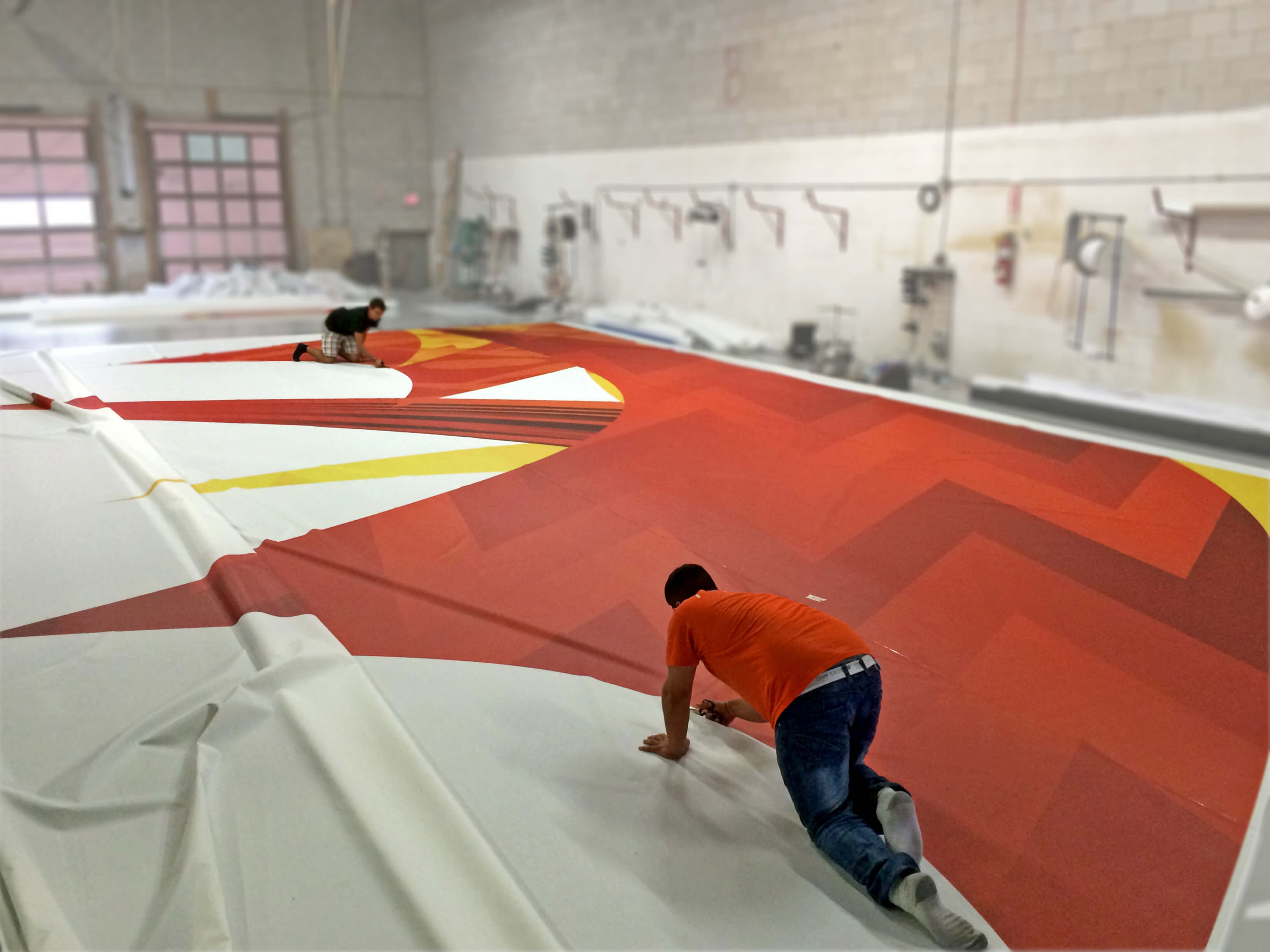 photo of giant Fifa banner being cut