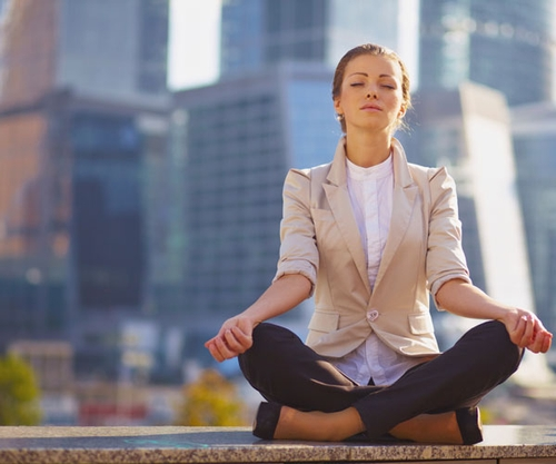 Picture of woman meditating to find her balance