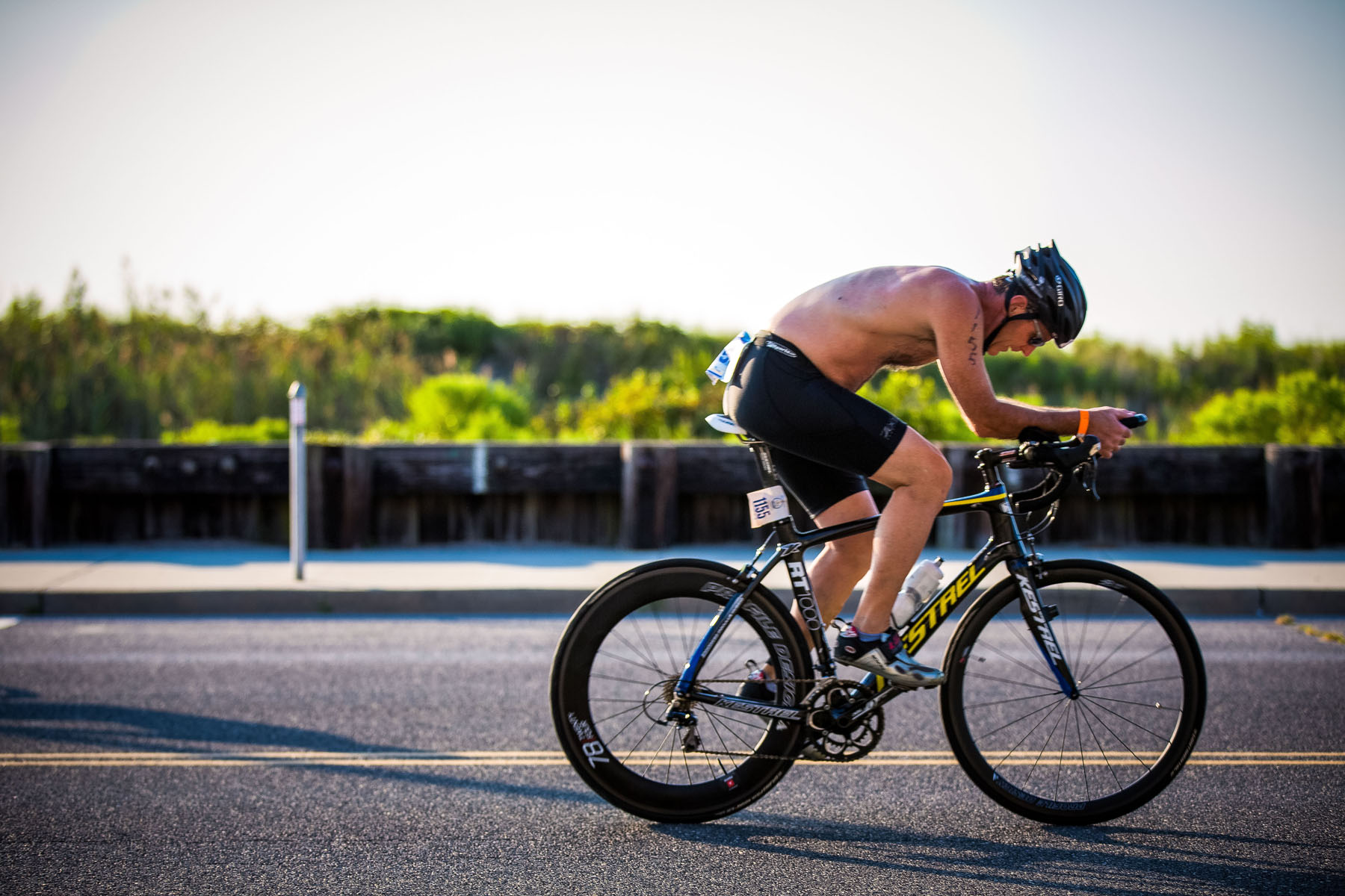 Tri The Wildwoods New Jersey Triathlon - Biking shirtless enjoy the beach sun rays