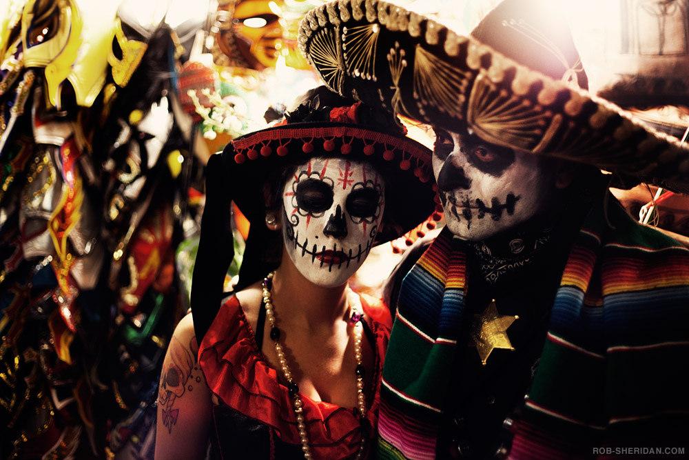 couple dressed up in dia de los muertos costumes