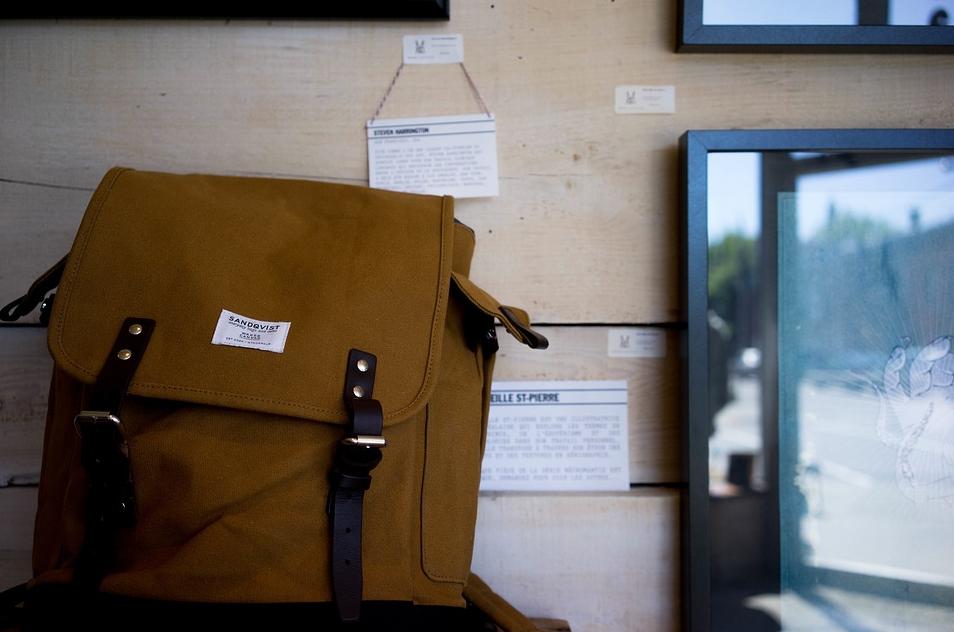 close-up of a messenger bag siting on a desk