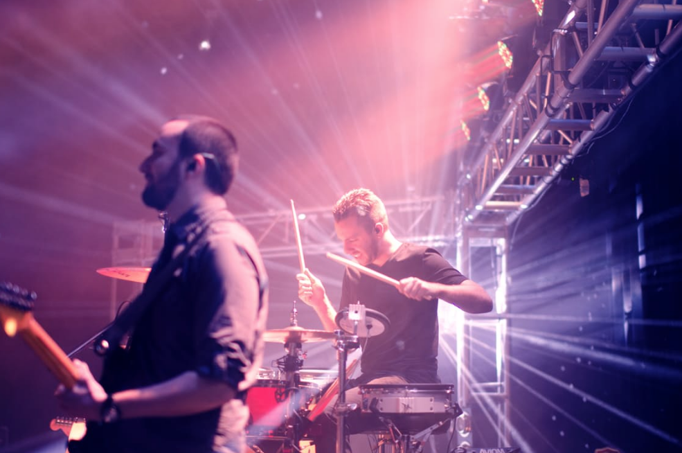 drummer and guitarist playing on stage