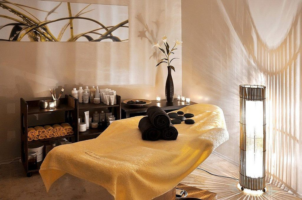 spa table with yellow and black towels on it