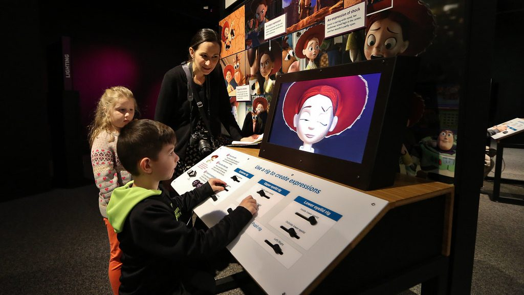 kid playing at pixar exhibit