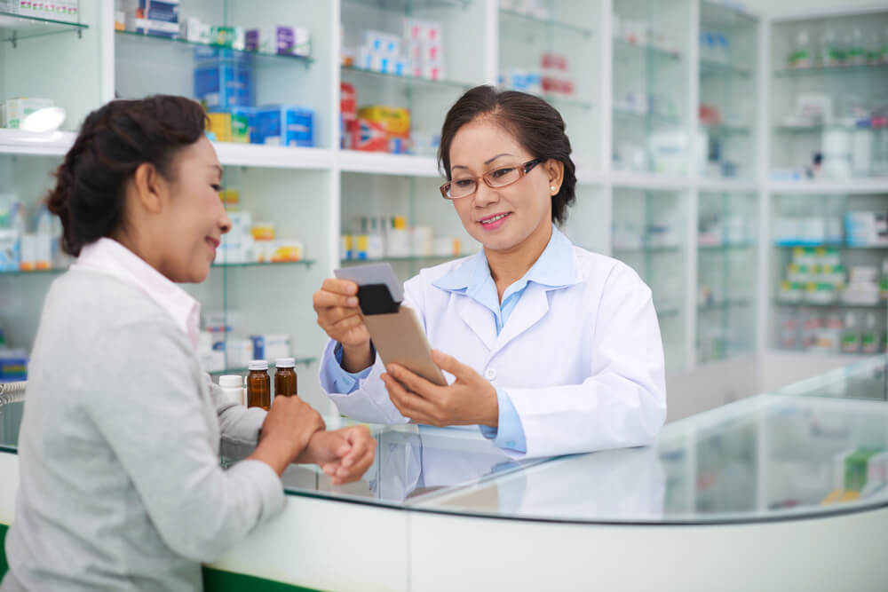 A pharmacist discussing medication with a patient