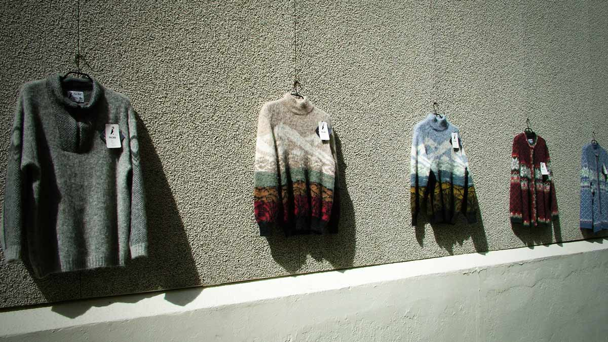 Icelandic Sweaters hanging on a wall for sale!
