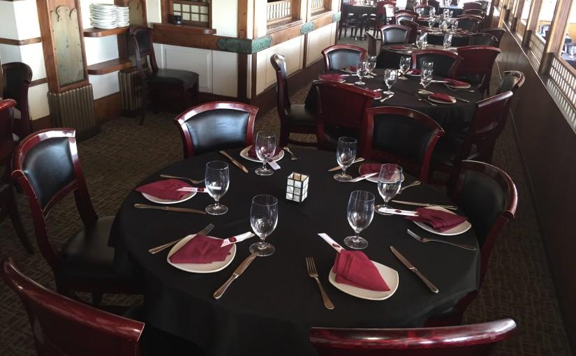 fine dining restaurant black tablecloth crimson napkins