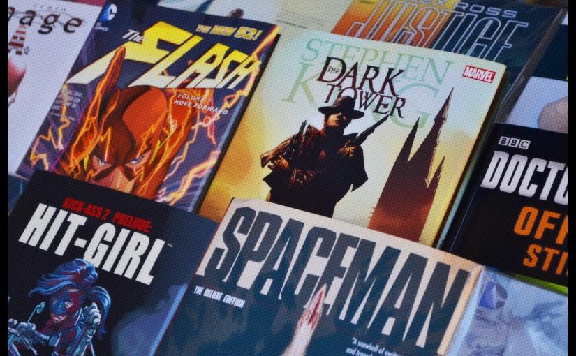 comic books in a comic book stand