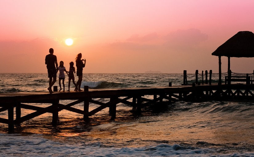 family enjoying the sunset on dock