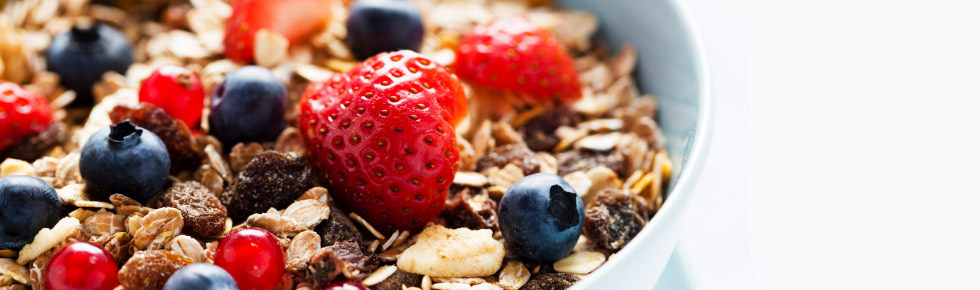 photo of breakfast cereal with fruit on top