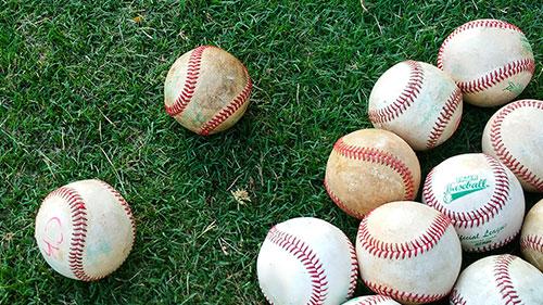 Photo of Baseballs on Grass. LakePoint Sports