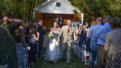Picture of outdoor wedding in front of outdoor chapel.