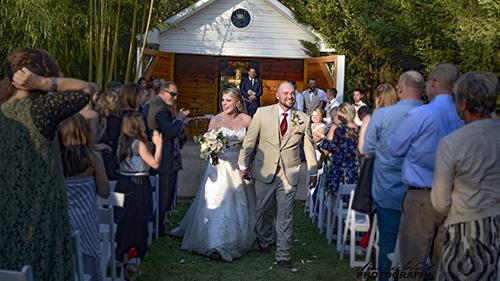 Picture of outdoor wedding in front of outdoor chapel.