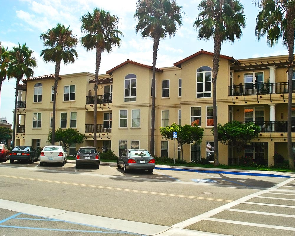 Carlsbad by the Sea building exterior and parking lot
