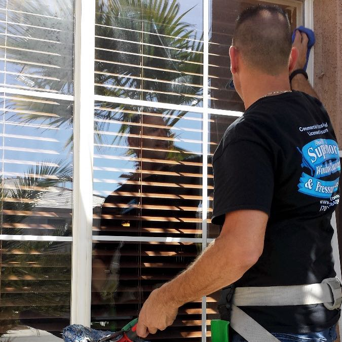 Cleaning windows on a home in Las Vegas