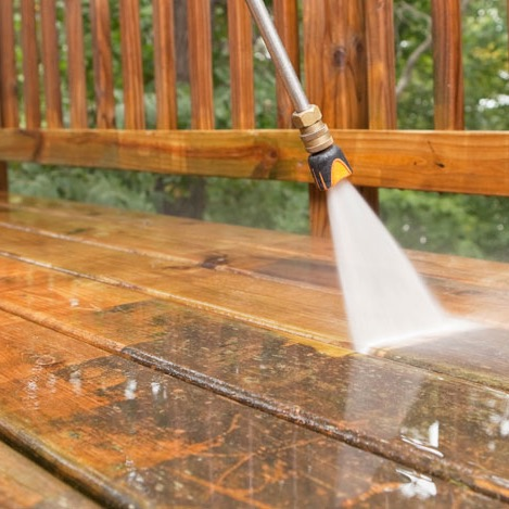 Pressure washing a deck at a home in Las Vegas